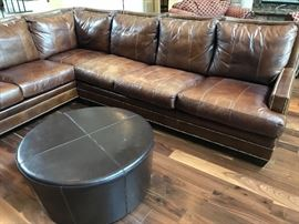 "Large sectional leather sofa by Ferguson Copeland, Ltd. measures 7'7"" by 9'9"""