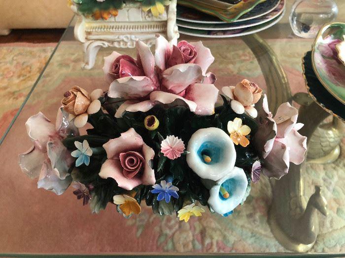We have a few Italian Capodimonte Flower centerpieces