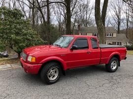 2001 Ford Ranger, 4 whl drive, auto  Has frame rust .  For parts only or will require frame repair. `New tires and battery.