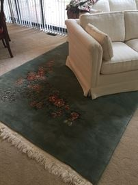 100% wool Chinese floral area rug and ivory love seat