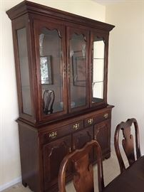 Mahogany china cabinet - lit  with glass shelves and bottom section is a sideboard - 2 pieces