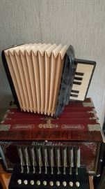 Accordion/Squeeze box and child's toy accordion