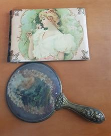 Celluloid autograph album and hand mirror.