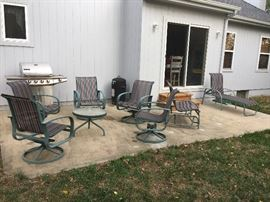 Patio furniture set - 5 swivel/rocker chairs, 2 person glider, side table and lounge chair, propane bbq grill with side burner and Brinkman smoker