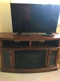 42 in. flat screen and electric fireplace TV stand -- like new