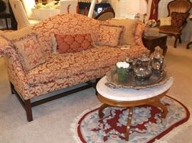 Beautiful camel back sofa and marble top coffee table