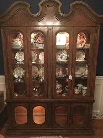 Mid Century China cabinet!  It's full of great pieces including two shelves of Mackenzie-Childs pottery.