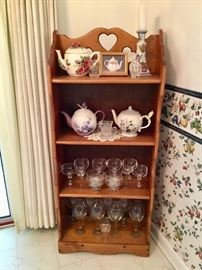 Country stand with teapots and glassware