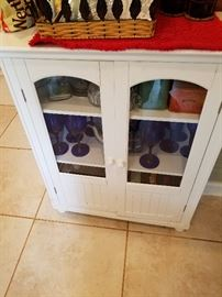White glass front cabinet perfect for glasses