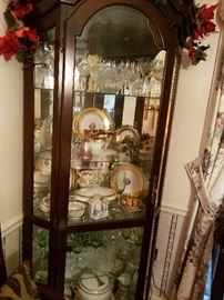 Beautiful large lighted glass cabinet full of great crystal, Waterford and More!`