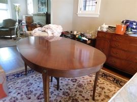 Oval  table  with  4  leaves  and  pads,buffet,rug