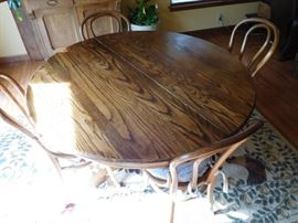 dinette  set-has  leaves  and  six  chairs