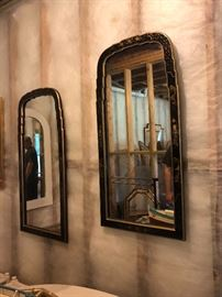 A pair of hand painted black lacquer mirrors.
