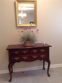 Very nice foyer and/or sofa table cherrywood nice mirror artificial plant