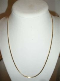 """""""SMALLS"""" Area:  This 14K gold necklace measures 18"""" long."""