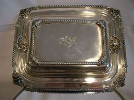 """""""SMALLS"""" Area:  A STERLING silver convertible covered casserole dish [monogrammed GDH] measures 11-l/2"""" x 9.""""  Notice the gadrooned borders and beautiful shell designs on the casserole dish corners and the lid. (Note:  As always, all sterling has been weighed and is priced above spot value. All gold and sterling have been removed from the premises and will be returned Saturday morning.)"""