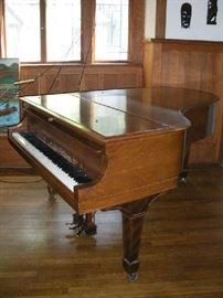 """Living Room:  A 1916 STEINWAY Model A grand piano (Serial #178389) is shown with its lid down.  Steinway introduced the Model A as its salon grand. It is known for delivering a grand sound and for its quality craftsmanship.  The Model A is the smallest of Steinway's concert grand pianos (this one measures 6'  4"""" from front of keyboard to end of tail) but one that is most often sought after by concert pianists.    History of this piano is in an upcoming photo."""