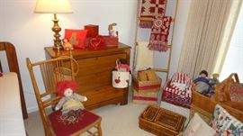 Primitive chest of drawers, needlepoint chair, baskets, blanket ladder,