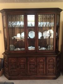 Large lighted China cabinet.