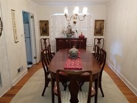beautiful dining room table and chairs.  Authentic reproduction Craftique Sideboard.