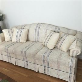 Clean sofa with throw pillows