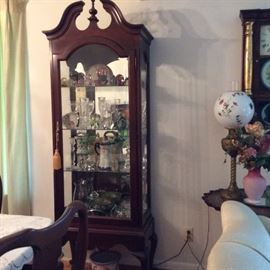Curio Cabinet filled with beautiful glass and etc.