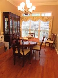 Kincaid Dining Room Set. Lighted china cabinet; table with 6 chairs (2 captain chairs), 2 extension leafs and mat
