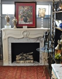 Wonderful wood fireplace mantle with faux marble and electric flickering log set.