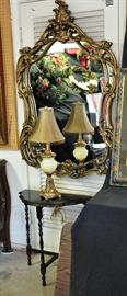 Large size fancy mirror with a half moon accent table and one of many accent lamps