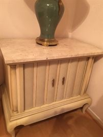 Vintage marble topped end table with  accordion doors.  Part of a set that includes a large end table,  small side table with accordion doors, 72 inch buffet with accordion doors, and breakfast table with 4 chairs.