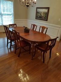 Dining room table and 6 chairs (includes custom pads for table)