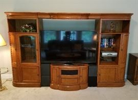 "Wall unit is expandable - the top center piece and center shelf (not pictured) both slide narrower/wider as needed (up to approx 70"" tv)"