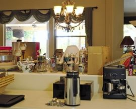 Cappuccino maker and all kinds of kitchen items including lots of assortment of wine related items for sale.