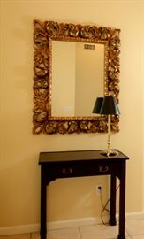 Ornate mirror and hallway table or use for a small desk or nightstand.