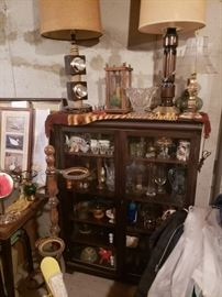 Antique cabinet; lamps; barometer; glassware; collectibles.