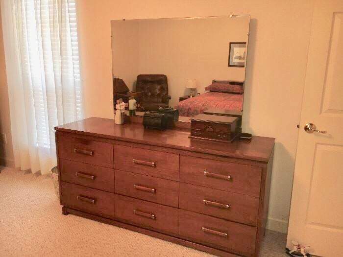 Mid-century modern bedroom group by Ramseur (Ramseur, NC) includes dresser with plate glass mirror, chest, queen bed with bookcase headboard and 2 nightstands. Each piece priced separately, or buy it all at a special price.