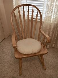 One of two wood rocking chairs.