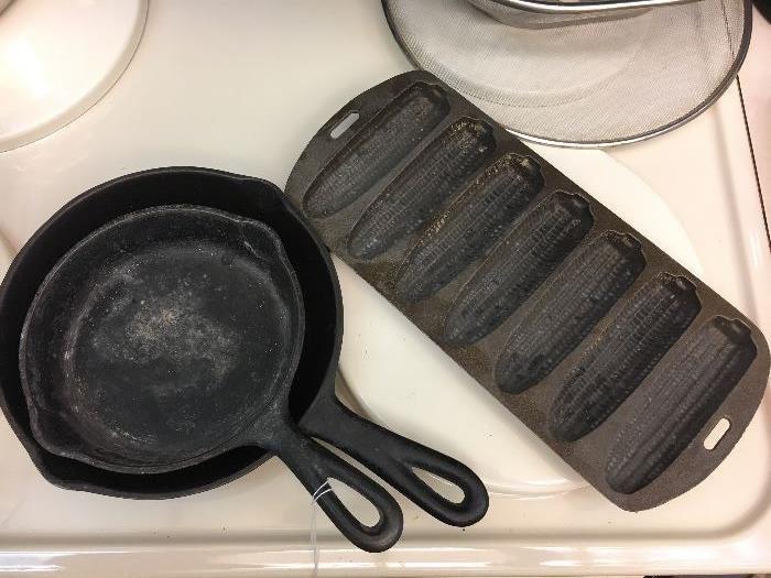 Antique cast iron cookware.