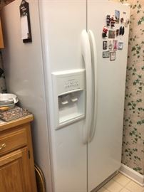 Older Kenmore refrigerator, side by side with ice and water in door.