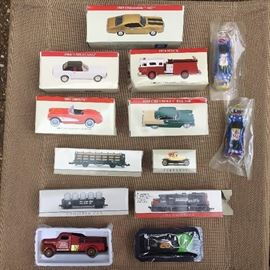 Assorted toy vehicles new in boxes.