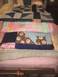 Antique quilt tops--one hand-pieced.