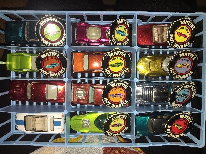 Over 40 1960s redline Hot Wheels cars, in played-with condition but not abused. Most have the coordinating metal badge.