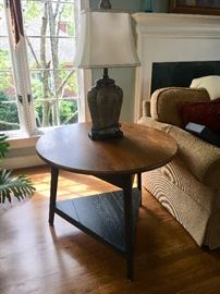 Casual farmhouse style round table—round top and triangle painted base.