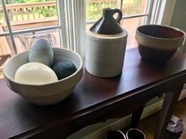 Antique crockery bowls and jug, shown with ostrich and emu eggs.
