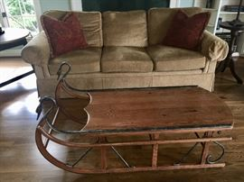 Top quality Henredon down sofa in camel color and Tell City Sleigh Coffee Table.