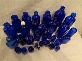 Large collection of  vintage cobalt blue glass bottles
