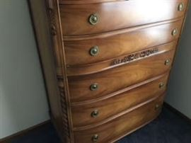 This dates back to 1946.  There is a vanity, full size dresser, night stand, chest(shown) and mirror.
