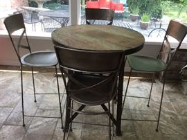 "Custom made from Leon & Lulu's  36"" round 40"" high distressed wood high top table w/metal frame and 2"" iron band.  Set includes 4 hammered metal stools/chairs also custom made 46"" tall with 30"" seat height.  This is an outstanding, one of a kind set"