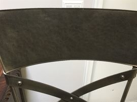 Hammered metal back of chair