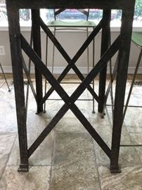 Metal leg base on table bottom